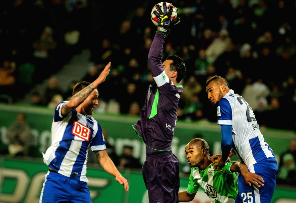VfL Wolfsburg's goalkeeper Diego Benaglio (2nd L) saves a goal during the German first division Bundesliga football match between VfL Wolfsburg and Hertha BSC in ...