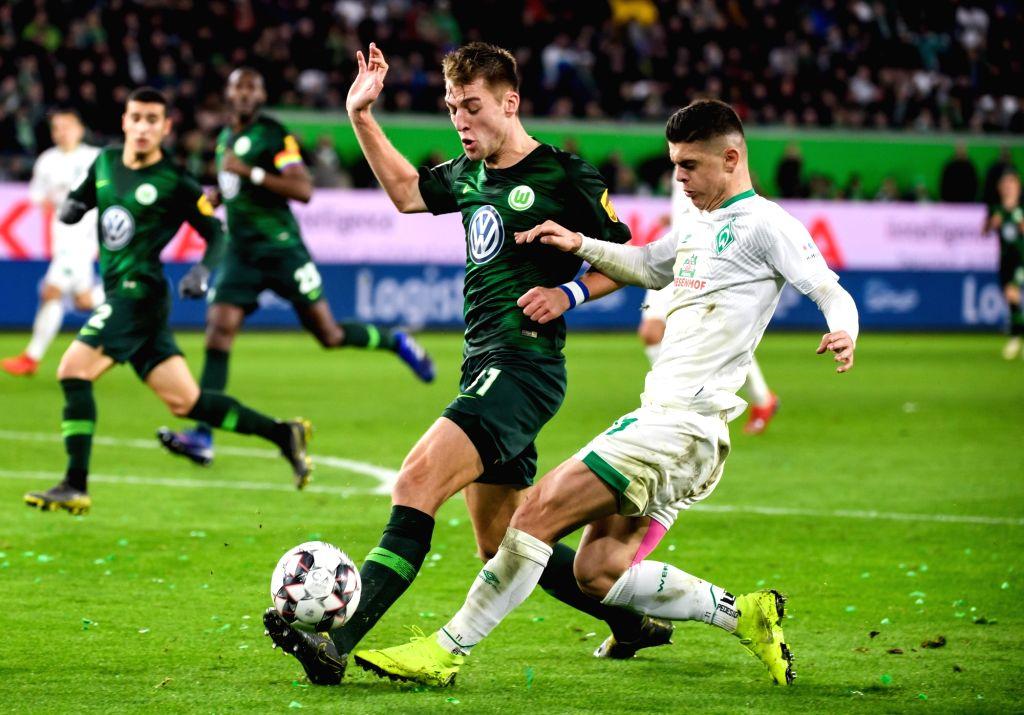 WOLFSBURG, March 4, 2019 - Bremen's Milot Rashica (1st R) vies with Wolfsburg's Robin Knoche (2nd R) during a German Bundesliga match between VfL Wolfsburg and SV Werder Bremen, in Wolfsburg, ...