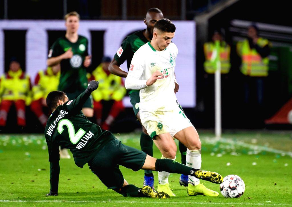 WOLFSBURG, March 4, 2019 - Bremen's Milot Rashica (top R) vies with Wolfsburg's William (bottom) during a German Bundesliga match between VfL Wolfsburg and SV Werder Bremen, in Wolfsburg, Germany, on ...