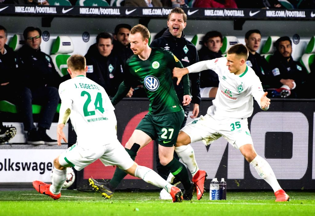 WOLFSBURG, March 4, 2019 - Wolfsburg's Maximilian Arnold (2nd L) vies with Bremen's Maximilian Eggestein (1st R) and Johannes Eggestein (1st L) during a German Bundesliga match between VfL Wolfsburg ...