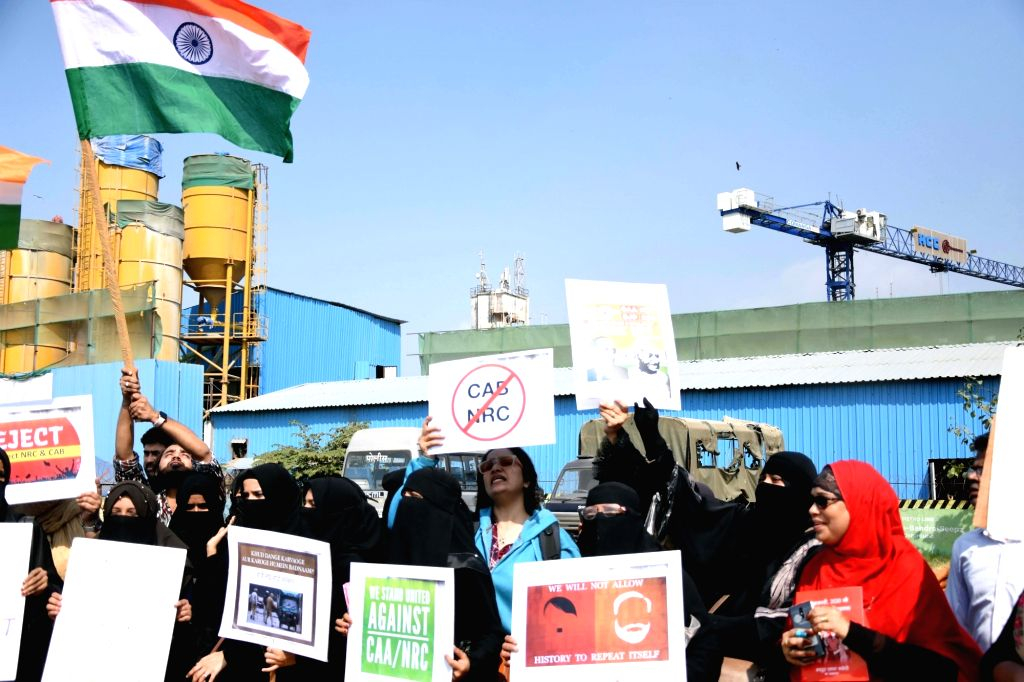 Women activists stage a demonstration against CAA, NRC and NPR during a nationwide strike called by central trade unions against central government's disinvestment policies, in Mumbai on Jan ...