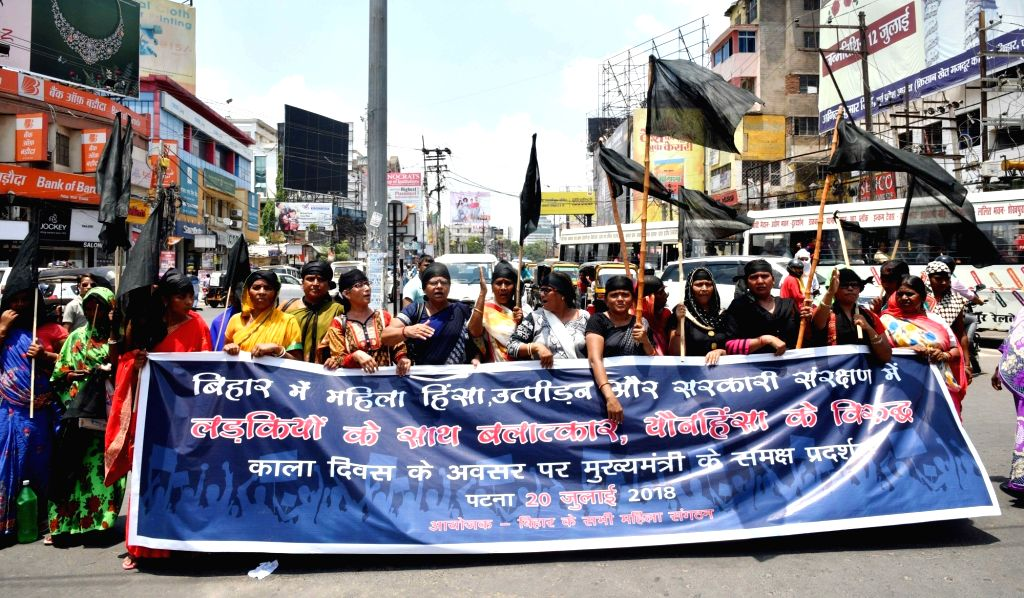 Women activists stage a protest against atrocities against women in Patna, on July 20, 2018.