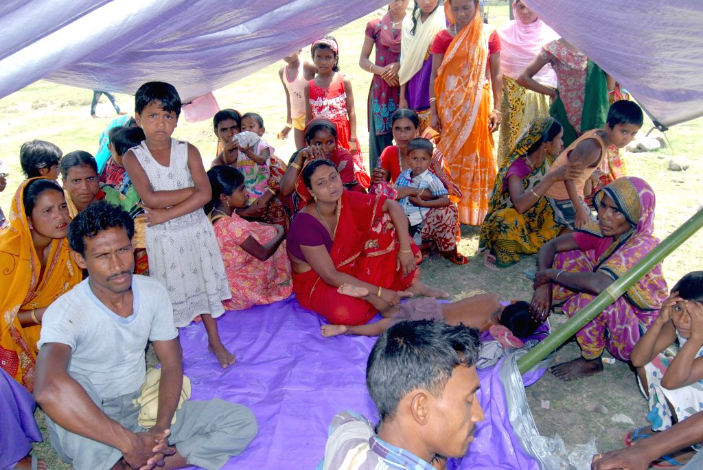 Women and children who fled their villages in light of the recent violence in Bodoland Territorial Area Districts (BTAD) at Narayanguri Relief Camp in Baksa district of Assam on May 6, 2014. The ...