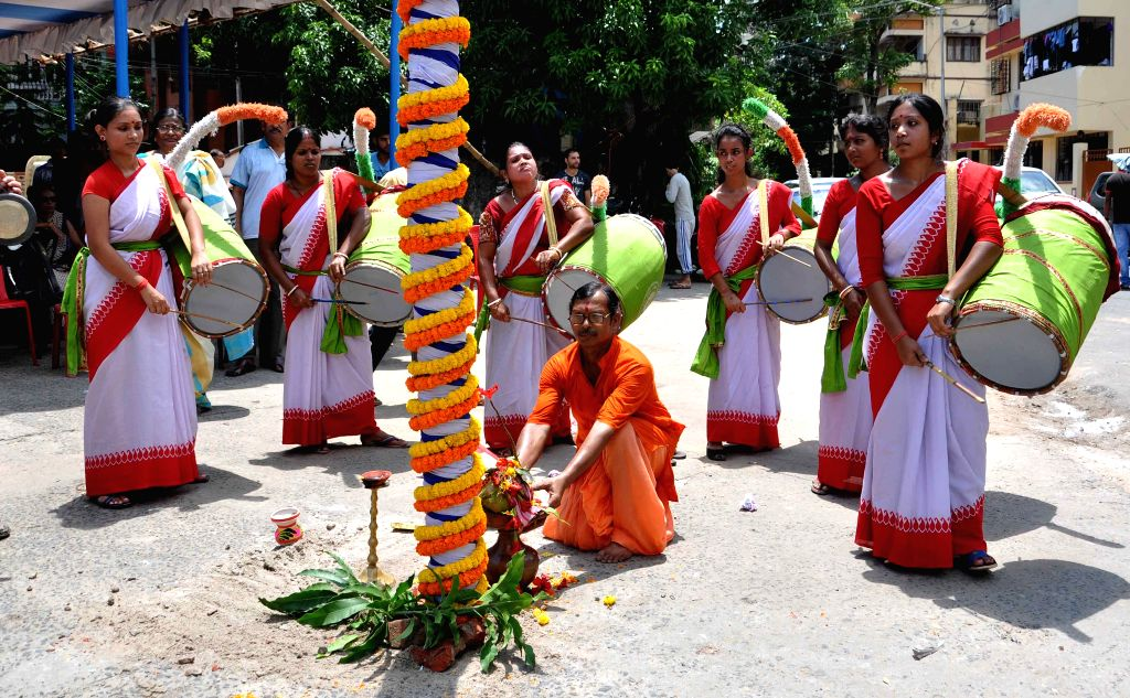 Women beat `dhaks` -drums- during a programme organised to mark the the beginning of preparations for Durga Puja at Salt Lake in Kolkata, on Aug 9, 2015.