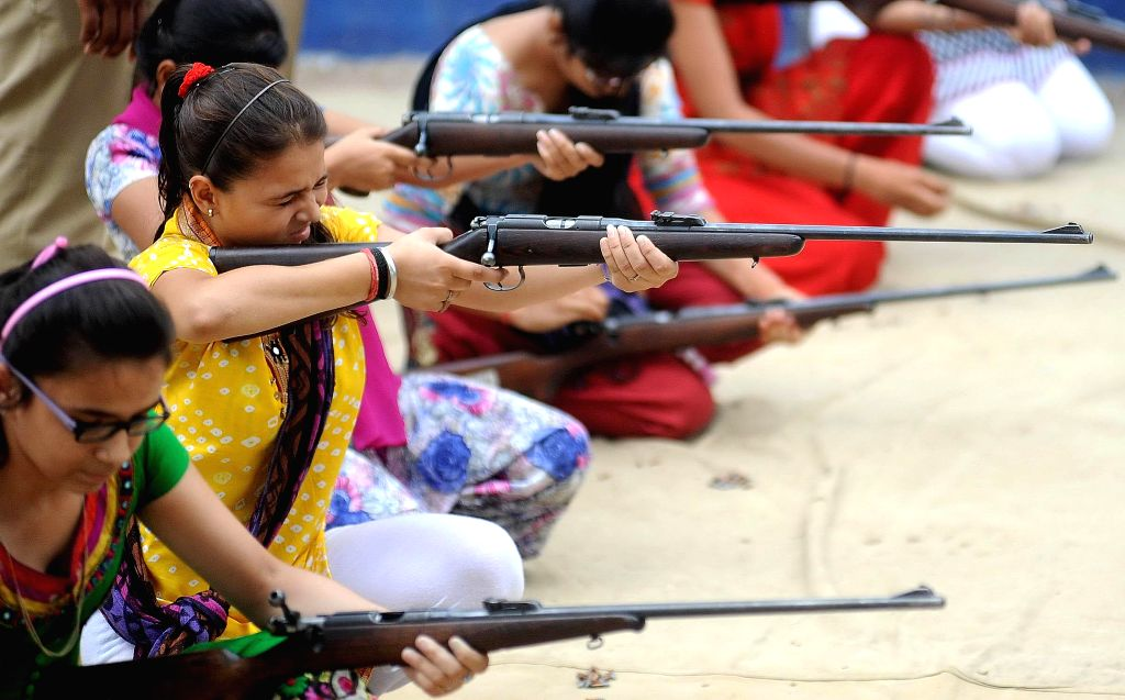 Women being given rifle firing training by Ahmedabad Police at police headquarters under Suraksha Setu initiative in Ahmedabad on June 16, 2014.