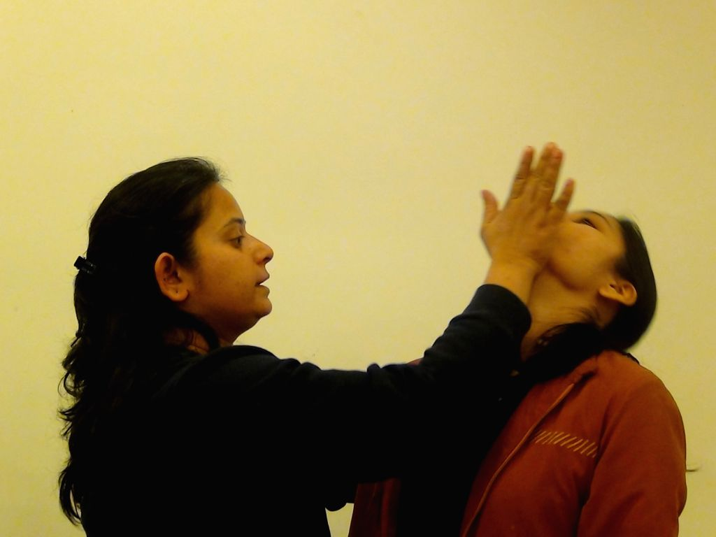 Women  being  taught self defence tips at the workshop.