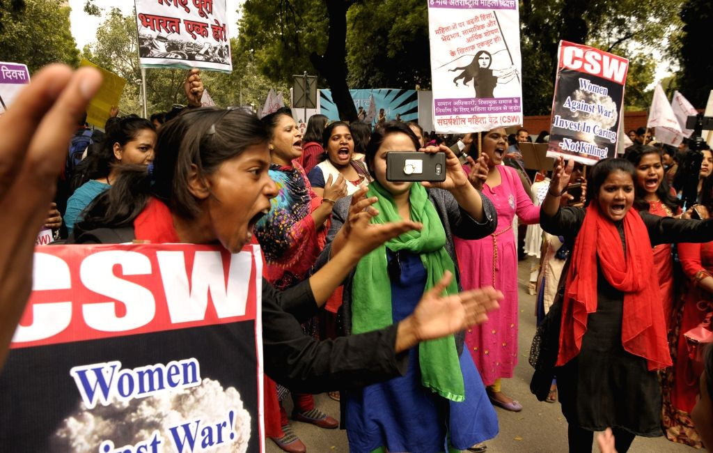Women belonging to various organsations stage a demonstration on International Women's Day 2019 in New Delhi on March 8, 2019.