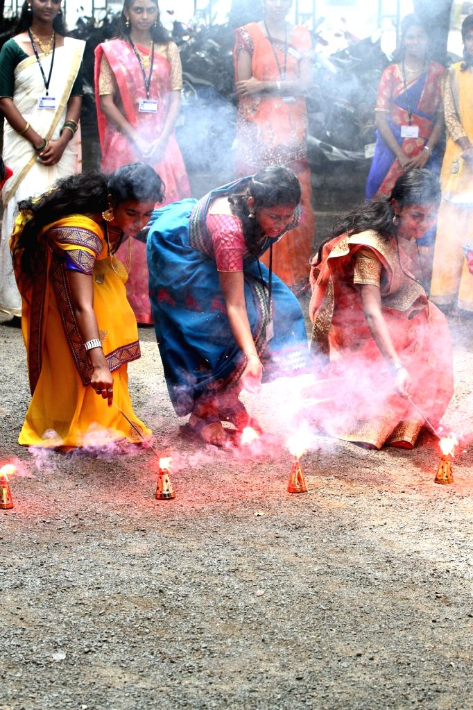 Women burn firecrackers as they participate in Diwali celebrations ahead of the festival in Chennai on Oct 25, 2019.