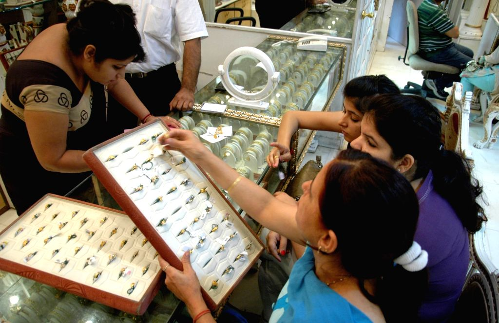 Women busy buying Gold ornaments on the occasion of Dhanteras. (File Photo: IANS)