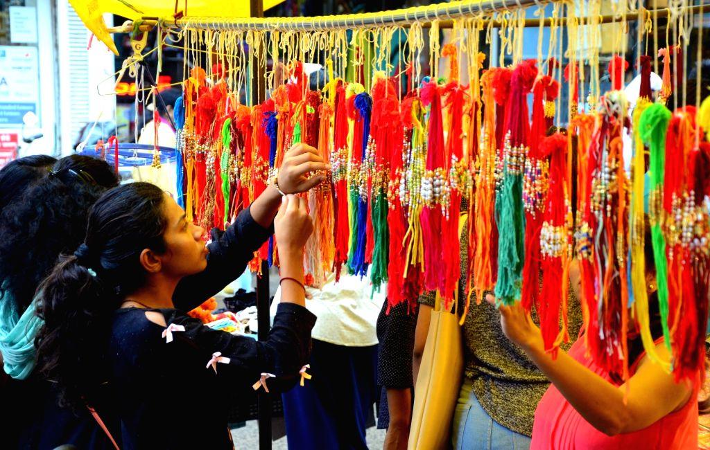 Women busy buying 'rakhis' ahead of Raksha Bandhan in Nagpur on Aug 13, 2019.