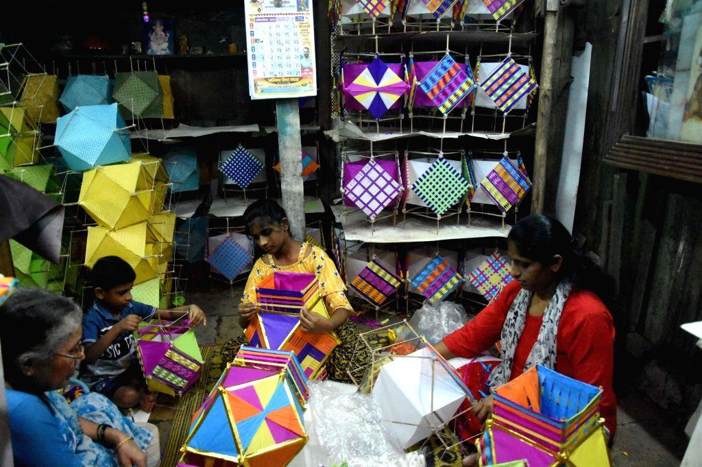 Women busy making eco-Friendly Sky Lanterns ahead of Diwali celebrations, in Mumbai on Oct 28, 2020.