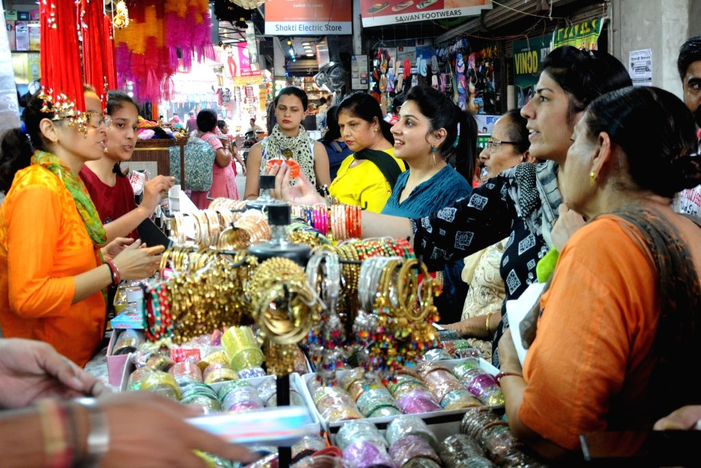 Women busy shopping ahead of Karva Chauth celebrations, in Amritsar on Oct 16, 2019.
