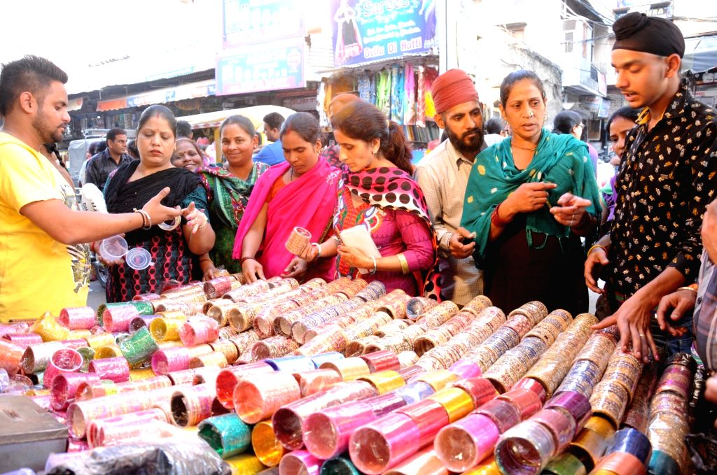 Women busy shopping ahead of Karwa Chauth in Amritsar, on Oct 29, 2015.