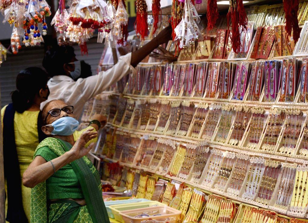 Women busy shopping for Raksha Bandhan at a market in Patna on July 30, 2020.