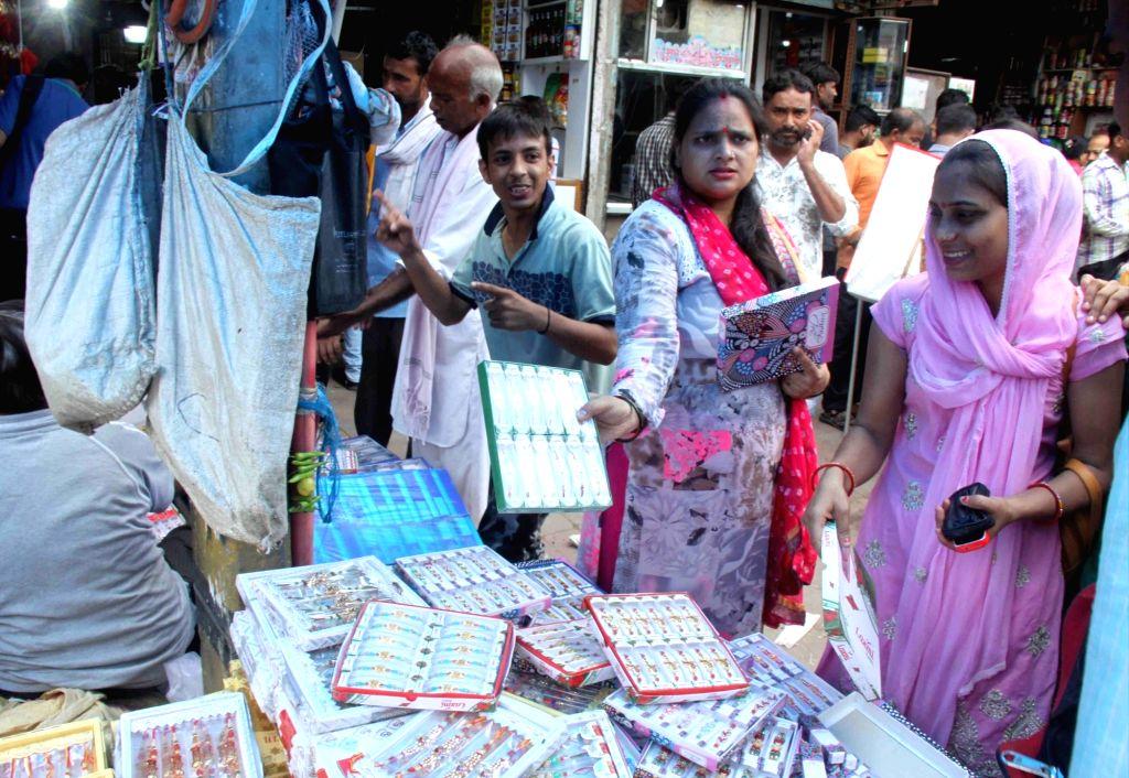 Women busy shopping for Raksha Bandhan on the eve of the festival, in New Delhi on Aug 14, 2019.