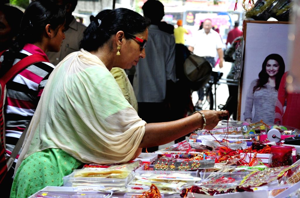 Women busy with Rakhi shopping ahead of Raksha Bandhan in Amritsar on Aug 5, 2017.