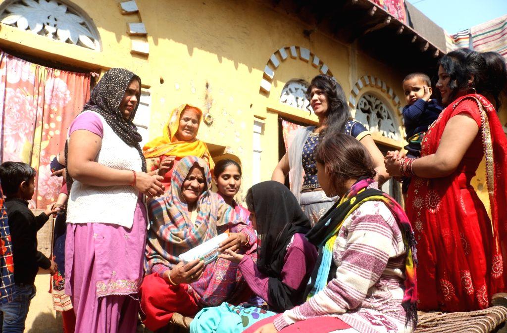 Women busy working at the pad-manufacturing factory in Kathikhera, Hapur, Uttar Pradesh.