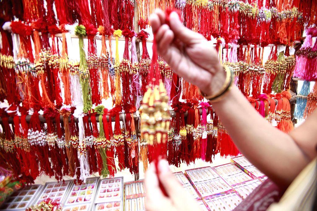 Women buy rakhis ahead of Raksha Bandhan in Mumbai on Aug 4, 2014.