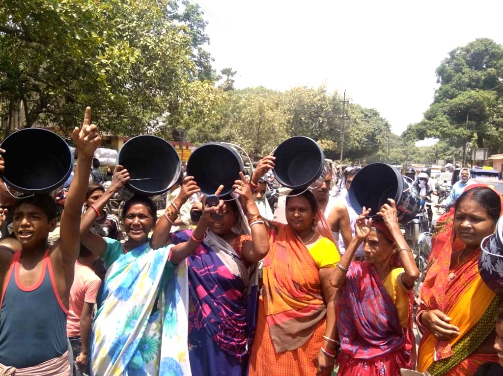 Women carrying empty buckets stage a demonstration against water scarcity, in Patna on June 15, 2019.