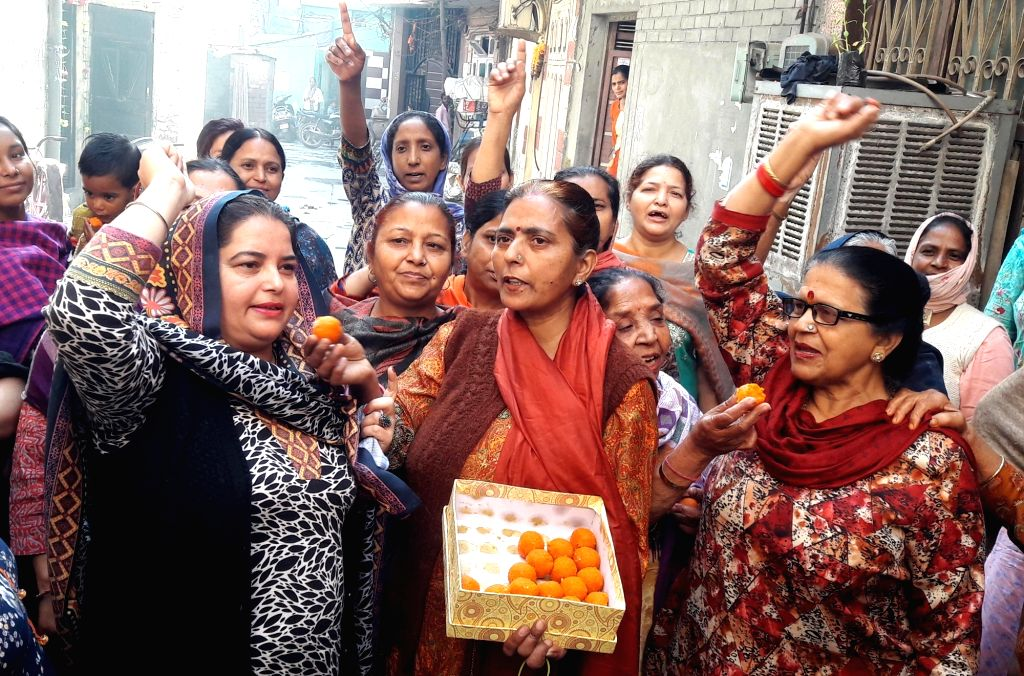 Women celebrate after the four persons convicted for the gruesome gang-rape and murder of a 23-year-old medical student in 2012 were hanged in the wee hours of Friday; in Amritsar on March ...