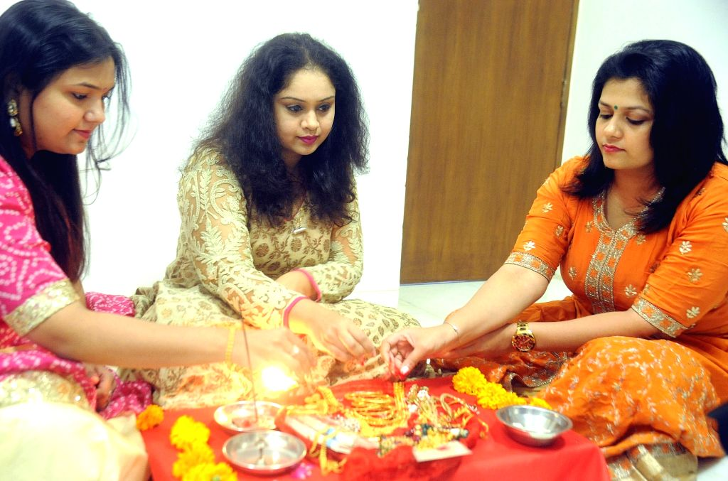 """Women celebrate """"Dhanteras"""" in Ahmedabad, on Oct 27, 2016."""
