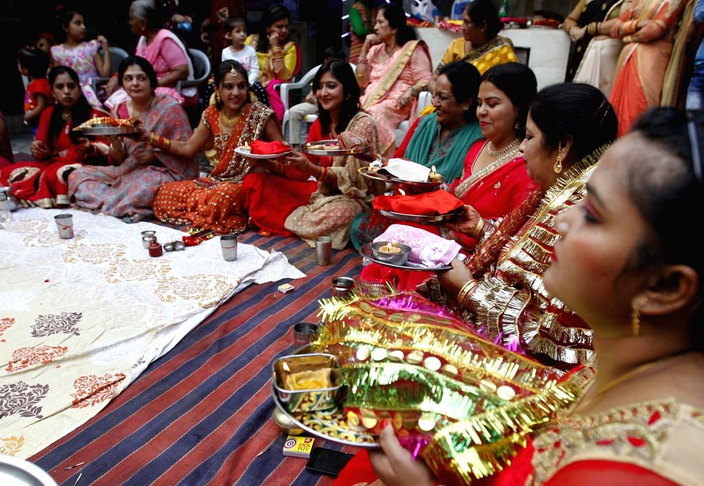 Women celebrate Karva Chauth in Allahabad on Oct 19, 2016.