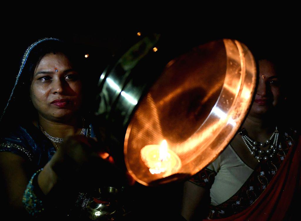 Women celebrate Karva Chauth in New Delhi on Oct 19, 2016.