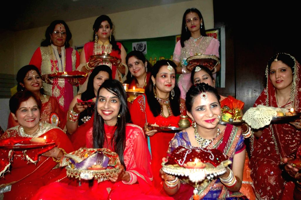 Women celebrate Karva Chauth in Patna on Oct 19, 2016.