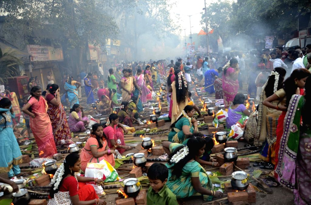 Women celebrate `Pongal` at Dharavi in Mumbai on Jan 15, 2016.