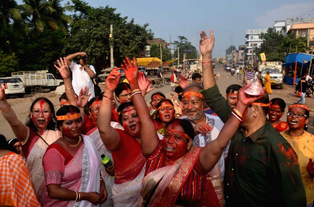Women celebrate 'Sindoor Khela' as people participate in a procession for the immersion of the idol of Goddess Durga on Vijayadashami, in Patna on Oct 8, 2019.