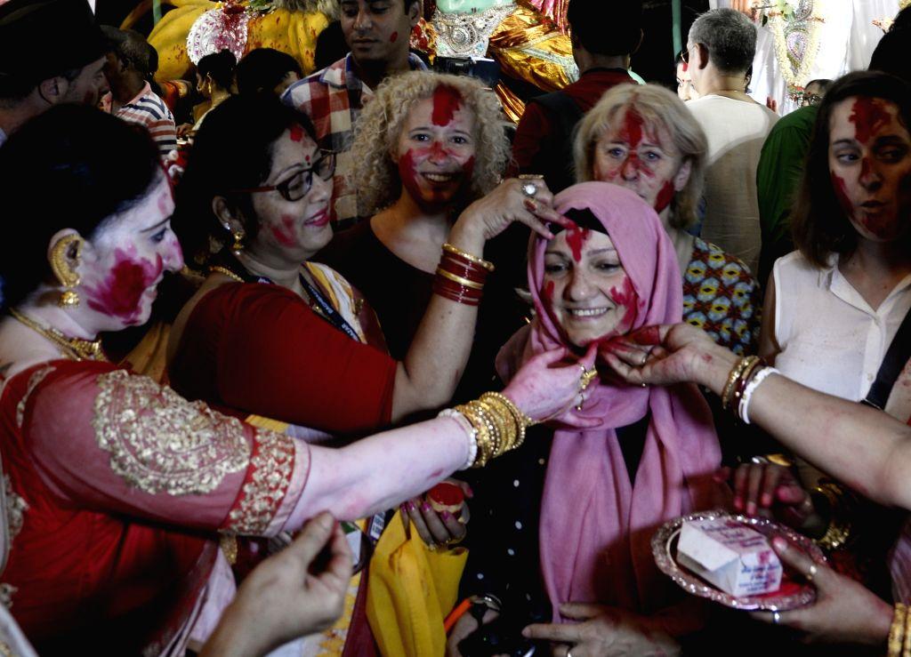 Women celebrate 'Sindoor Khela' on Vijayadashami, in Kolkata on Oct 8, 2019.