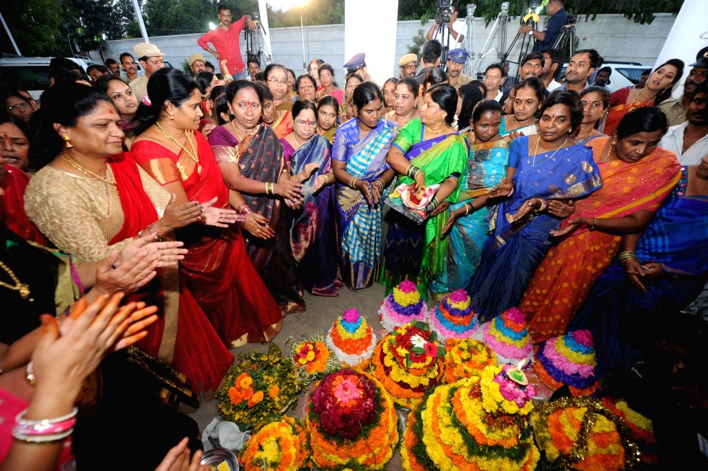 Women celebrates Bathukamma festival in Hyderabad on Oct 17, 2015.