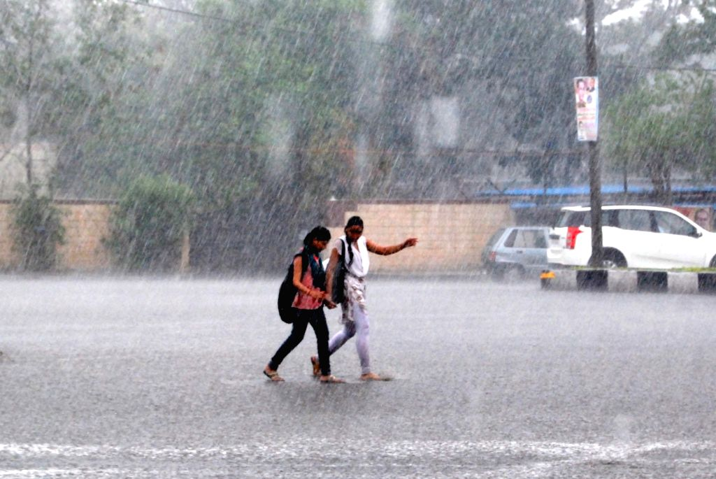 Women enjoy rains in Bhopal on June 23, 2016.