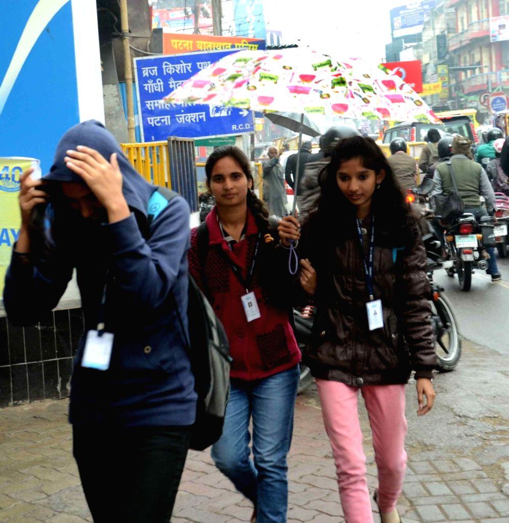 Women enjoying winter rains in Patna on Jan 19, 2016.