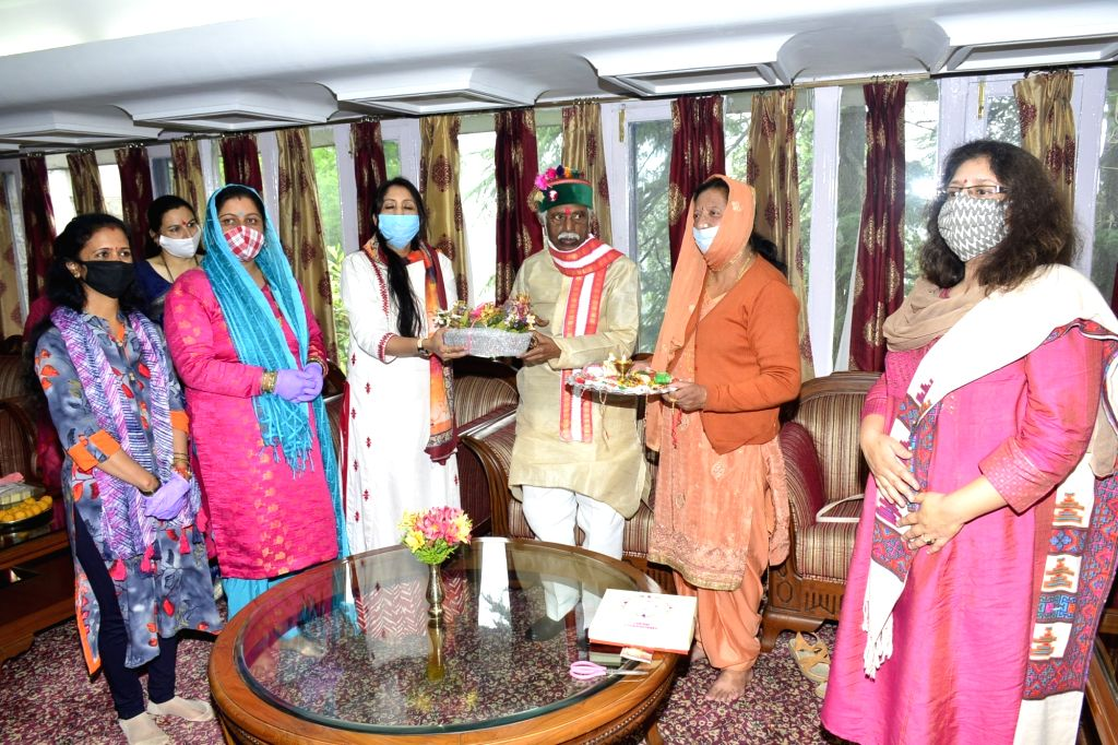 Women folk from various sections of the society tied colourful Rakhis on the wrist of Himachal Pradesh Governor Bandaru Dattatraya during Raksha Bandhan celebrations at Raj Bhavan, in Shimla ...
