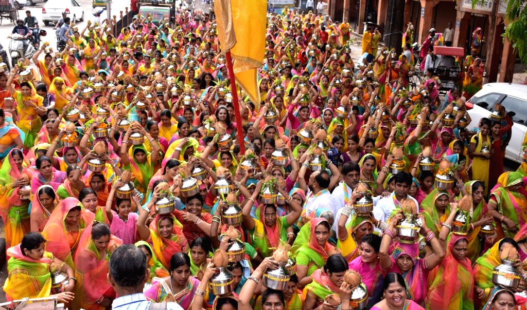 Women in large numbers participate in Kalash Yatra during the holy month of Sharvan in Jaipur, on Aug 14, 2016.