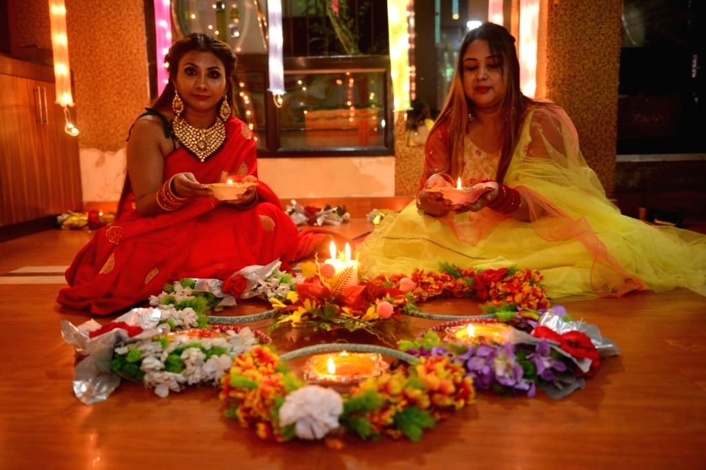 Women light up earthen lamps at their residence on the occasion of Diwali in Patna on Nov 14, 2020.