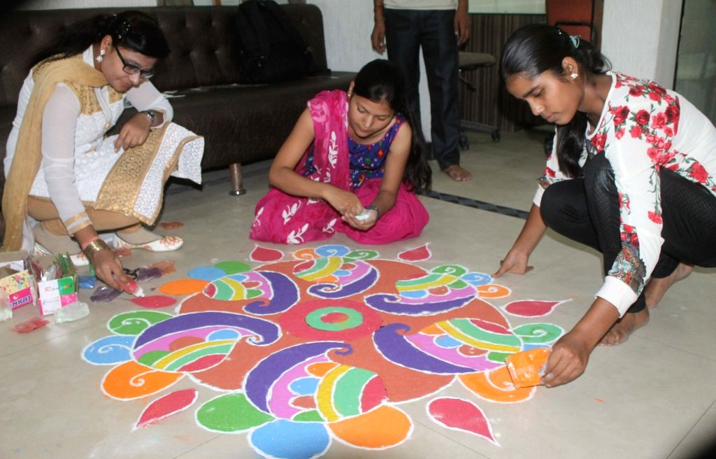 Women make rangoli at their homes on Dhanteras in Mathura on Oct 28, 2016.