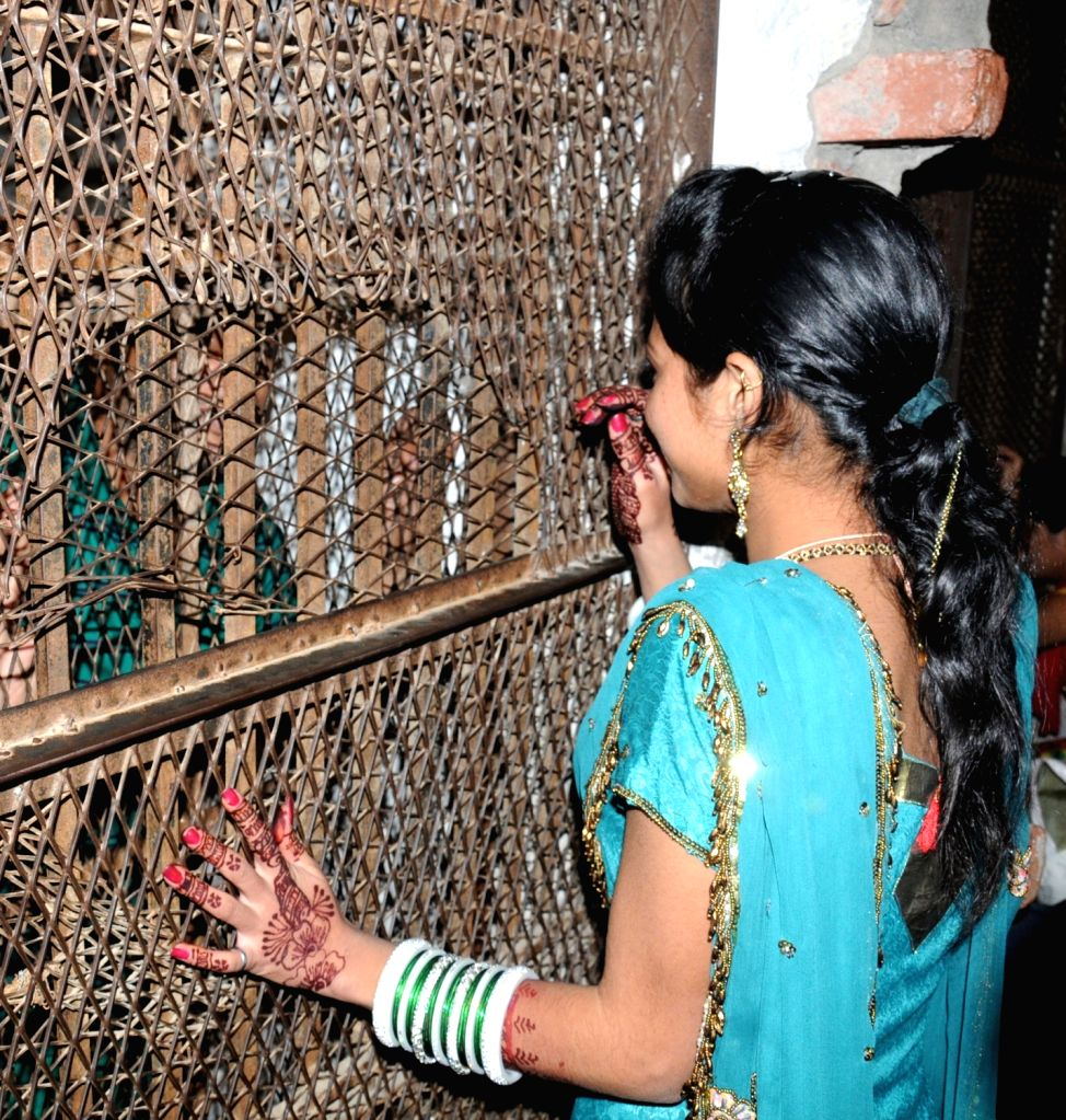 Women meet their husbands who are prisoners in Central Jail Amritsar as jail authorities made spacial arrangements on the occasion of `Karva Chauth` in Amritsar on Oct 30, 2015.