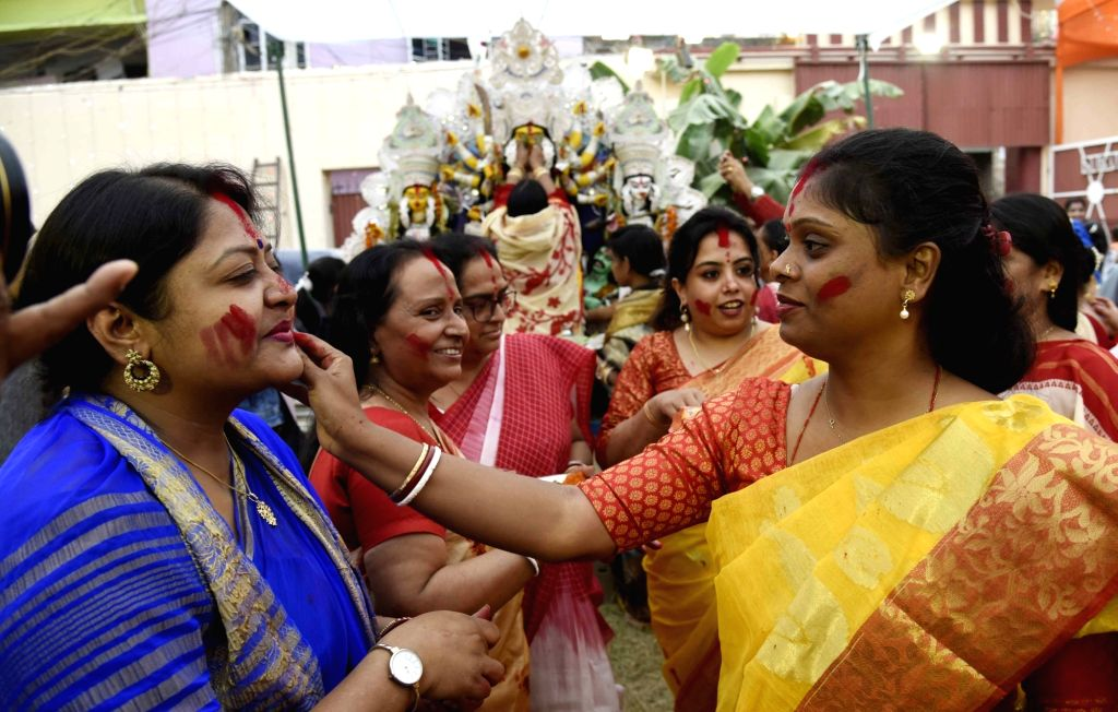 Women offer prayers to Goddess Durga and perform 'Sindur Khela' during Vijayadashami celebrations ahead of Durga idol immersion, in Patna on Oct 26, 2020.