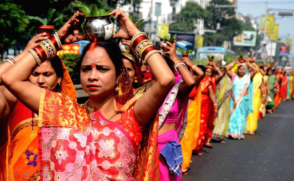 Women participate during Kabi Vidyapati Kalash Yatra in Kolkata on Nov. 17, 2019.