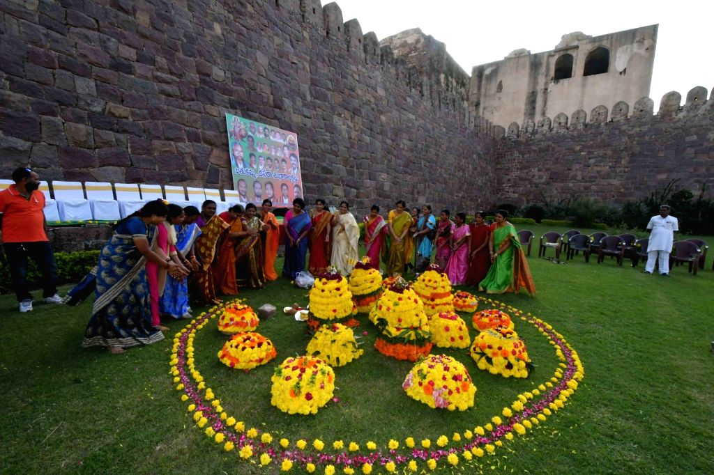 """Women participate during the """"Bathukamma"""" - the floral festival of Telangana at Golconda fort in Hyderabad on Oct 4, 2016."""