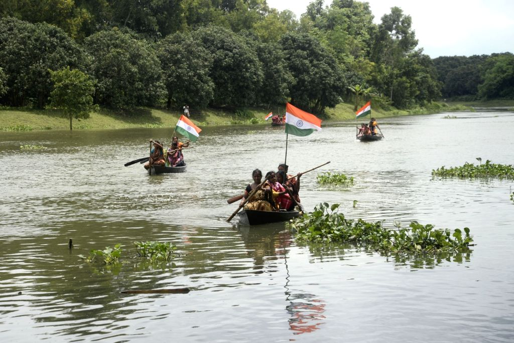 Women participate in a boat race on the occasion of Independence Day in Shibnibas village in the Nadia district of West Bengal on August 18, 2017. The region was earlier declared to be the ...