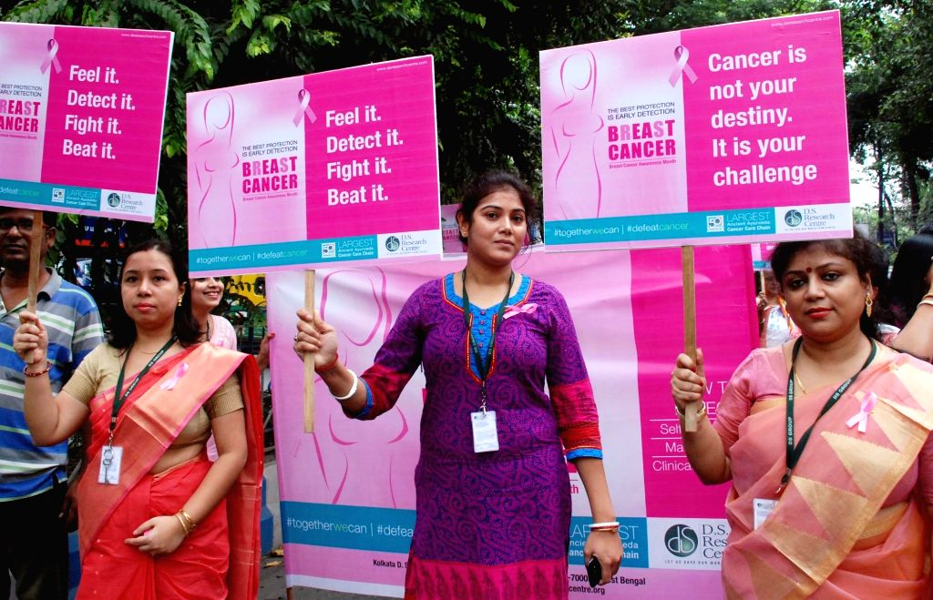 Women participate in a breast cancer awareness rally in Kolkata on Oct 26, 2016.