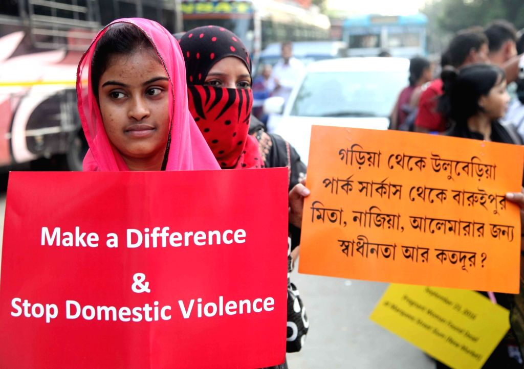 "Women participate in a protest rally against ""Domestic Violence"" in Kolkata on Nov 25, 2016."