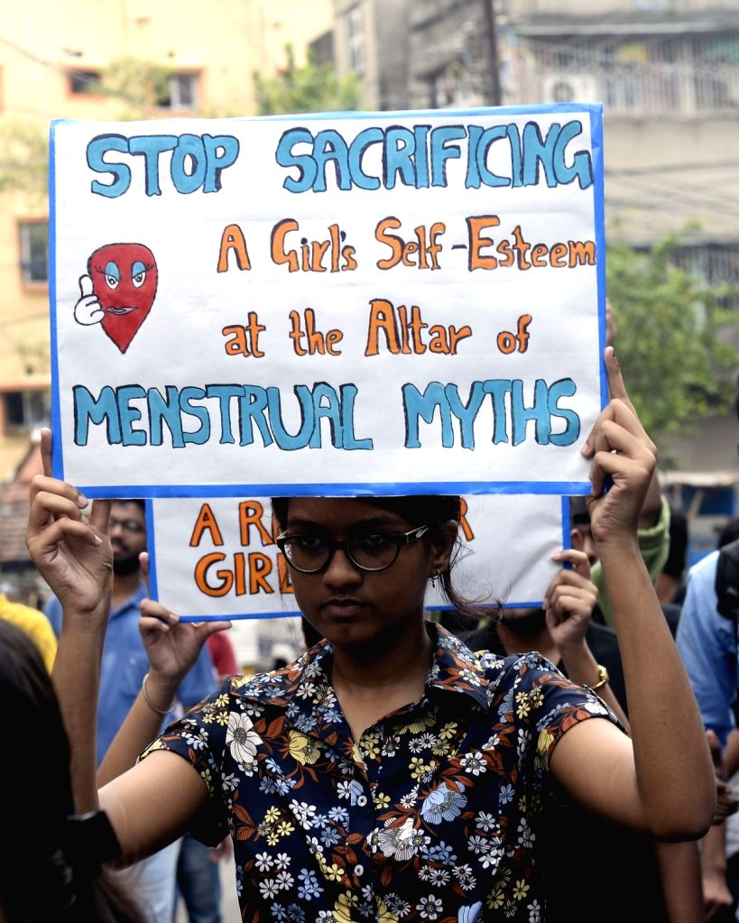Women participate in a rally to create awareness about menstrual hygiene on World Menstrual Hygiene Day, in Kolkata on May 28, 2019.