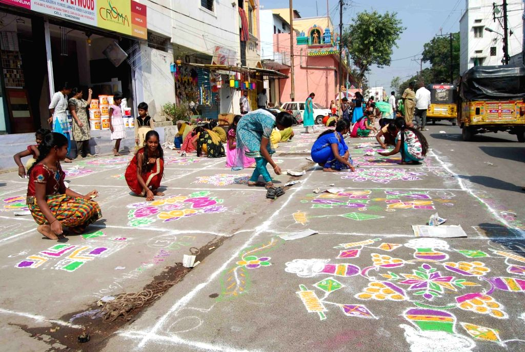 Women participate in a rangoli competition organised on the eve of Makar Sankranti in Hyderabad, on Jan 14, 2016.