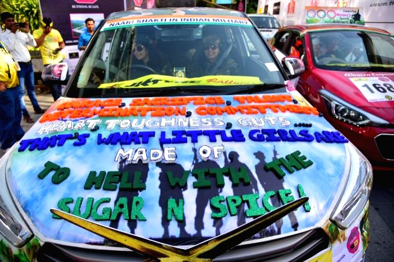 Women participate in an all-women car rally ahead of International Women's Day in Mumbai on March 5, 2017.