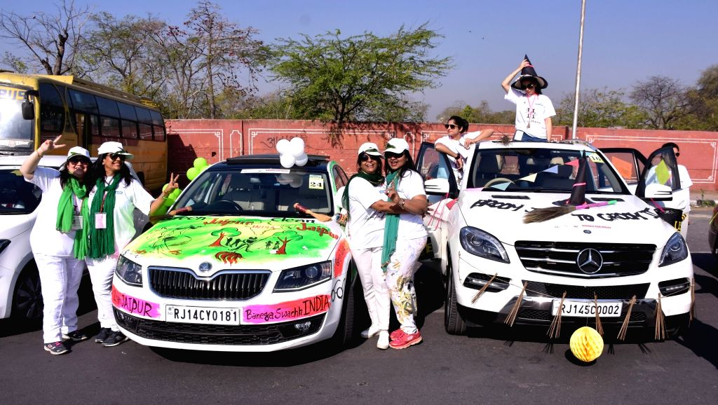 Women participate in an all-women car rally ahead of International Women's Day in Jaipur, on March 5, 2017.