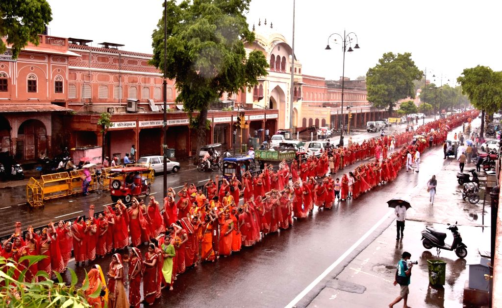 "Women participate in ""Kalash Yatra"" during rains in the Hindu holy month of 'Sawan' in Jaipur on Aug 10, 2019."